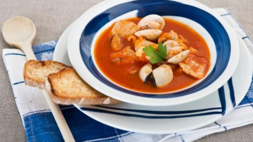 Photo of Receta de Lomos de salmón con almejas y salsa de pimientos de piquillo