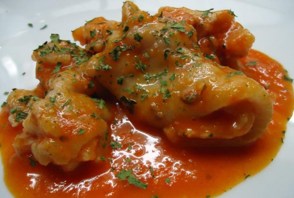 Photo of Receta de manitas de cerdo con tomate
